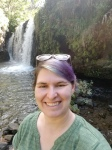 a photo of Amelia in front of a waterfall