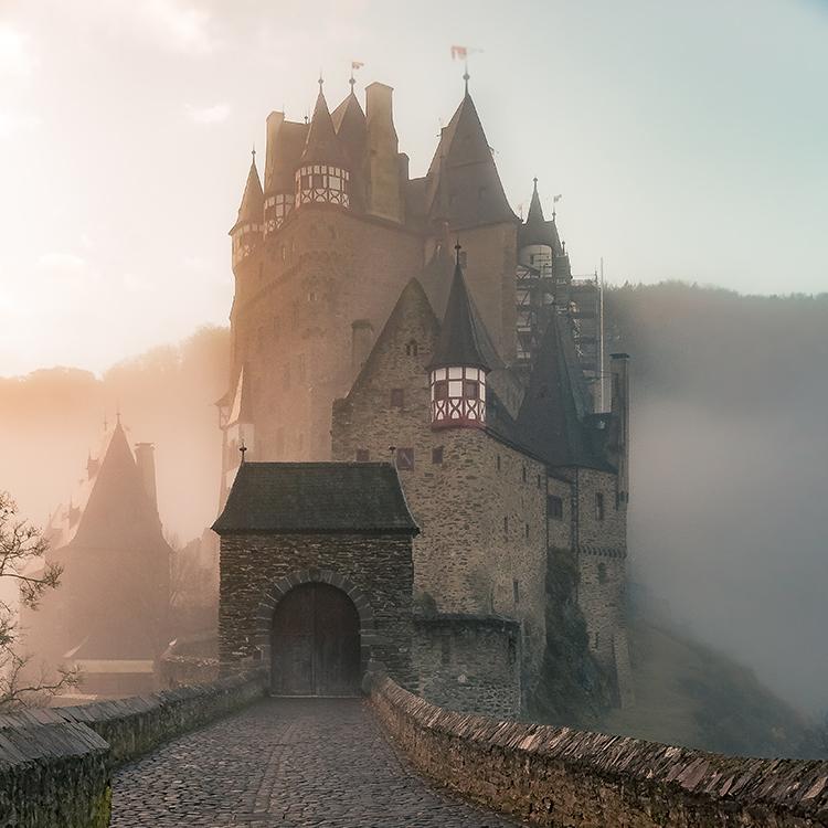 A castle on a misty morning.